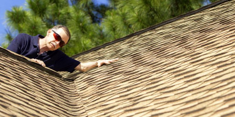 roofer inspecting a roof