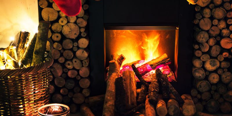 an indoor fireplace during wintertime and christmas