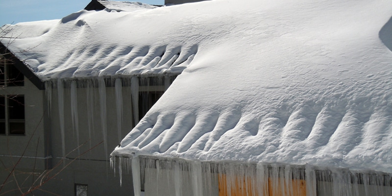 a snowy and icy roof