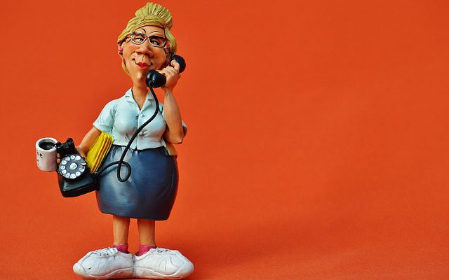 a sculpture of a woman on the phone