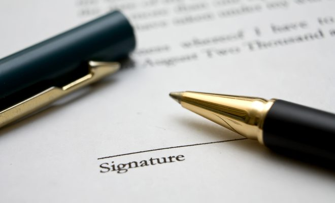a pen on an unsigned contract