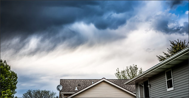 rain falling on residential roofs